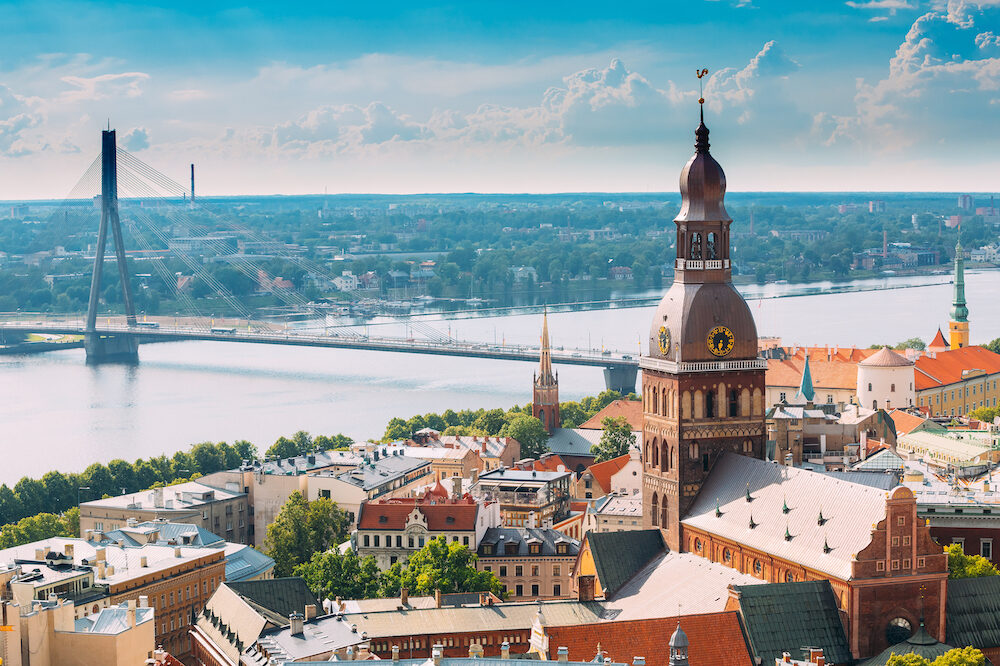 Riga, Latvia. Riga Cityscape In Sunny Summer Day. Famous Landmark - Riga Dome Cathedral