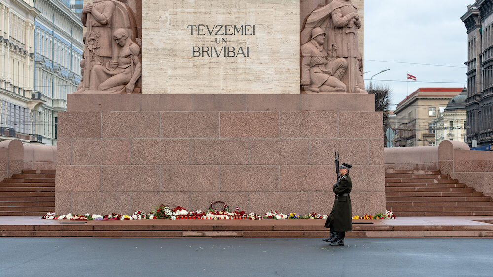 RIGA, LATVIA - Latvia 100 years. Soldiers guard of honor at the Freedom Monument. The inscription on the monument to Latvian FATHERLAND AND FREEDOM