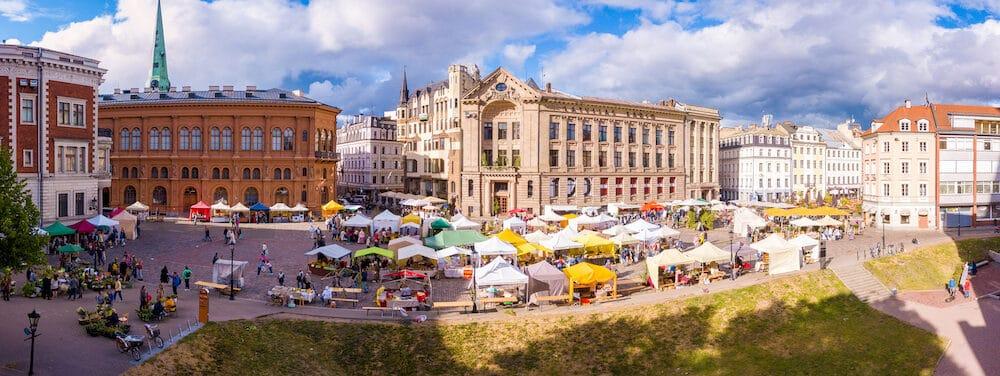 "RIGA, LATVIA,The Latvian Radio building in Riga Dome Cathedral Square, historic Old town (Vecriga), Riga, Latvia, Europe with Midsummer celebration market for ""Jani"" summer festival."