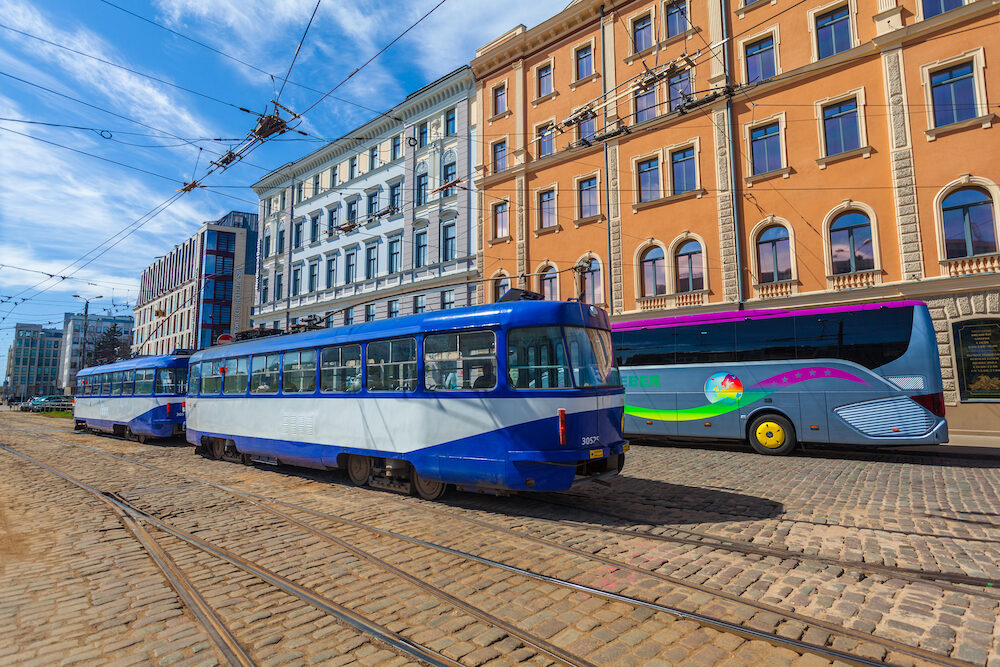 RIGA, LATVIA -View on the public transport - the tram in Riga, rail-tracks and buildings that are located in the city center of Riga