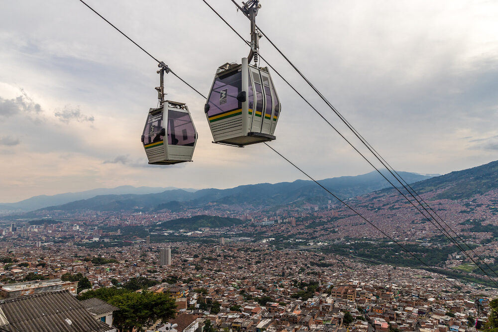 Medellin, Colombia.. A view of the mass transport system cable cars over Medellin in Colombia.