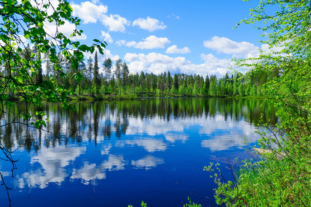 Landscape of lakes and reflections near Taipaleenoja, Posio, Lapland, Finland