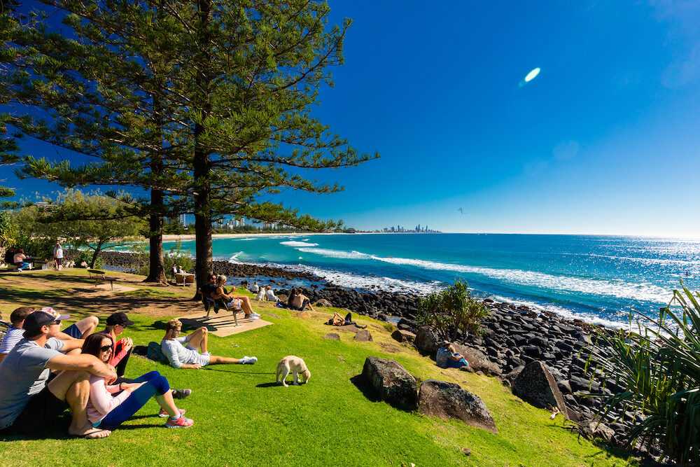 GOLD COAST, AUS - People watching Gold Coast skyline and surfing beach at Burleigh Heads, Queensland, Australia