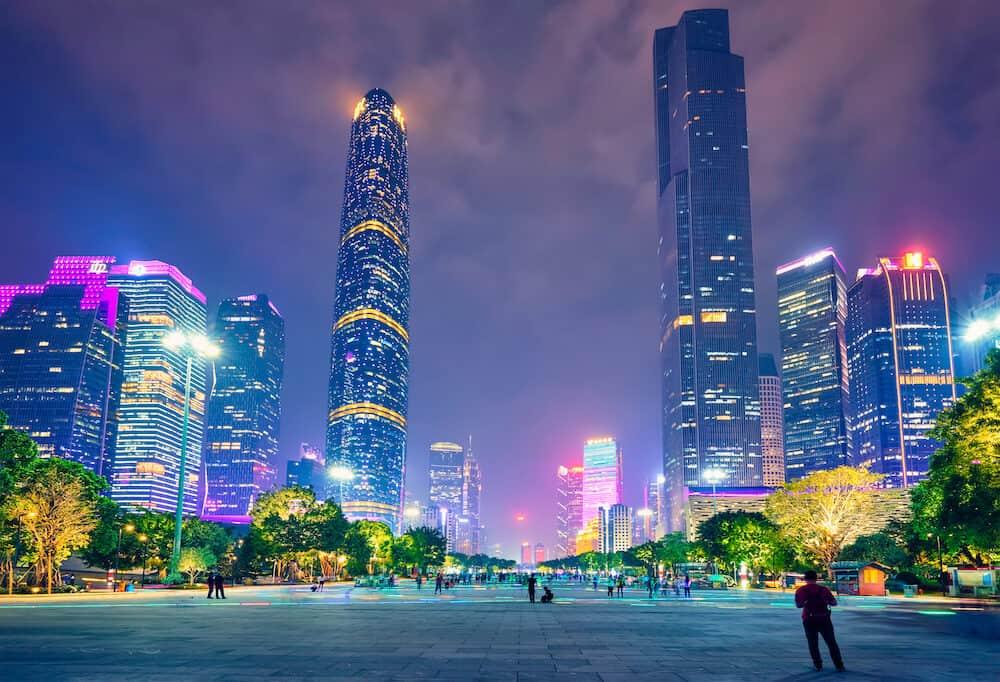 GUANGZHOU, CHINA - Guangzhou cityscape skyline over the Pearl River illuminated in the evening. Guangzhou, China