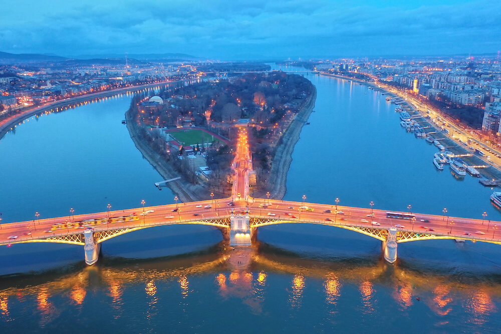 Budapest by night. Hungary - skyline panorama of Budapest in the night. The Danube and the Margaret island with the Margaret Bridge in front. Blue hour photo.