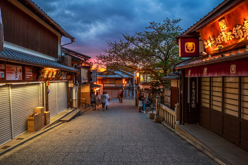 Kyoto, Japan - scenic and popular Ninen-zaka at dusk, Southern Higashiyama, a pedestrian street and cultural heritage with wooden houses, traditional shops and restaurants.