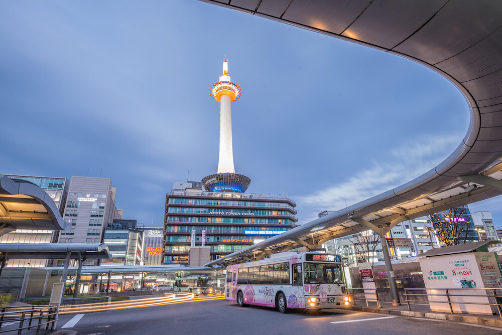 Kyoto Japan - Kyoto Tower in front of Kyoto Stationtower is the tallest in Kyoto height of 131 meters Kyoto Station is the city's transportation hub and also the site of a large bus terminal for city buses.