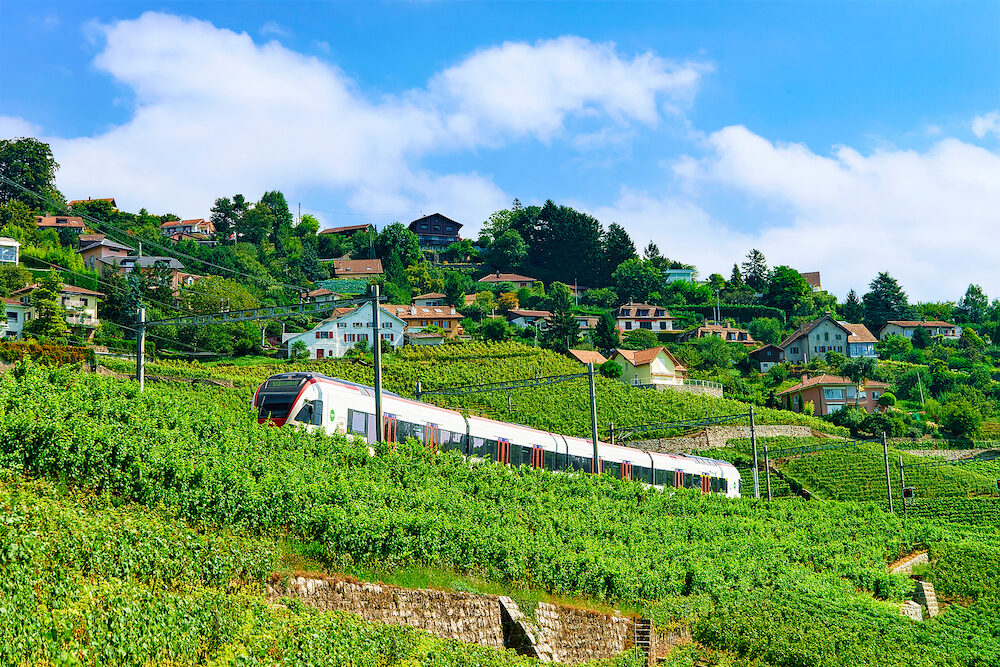 Lavaux, Switzerland - : Running train at the railroad near Lavaux Vineyard Terrace hiking trail, Lavaux-Oron district, Switzerland