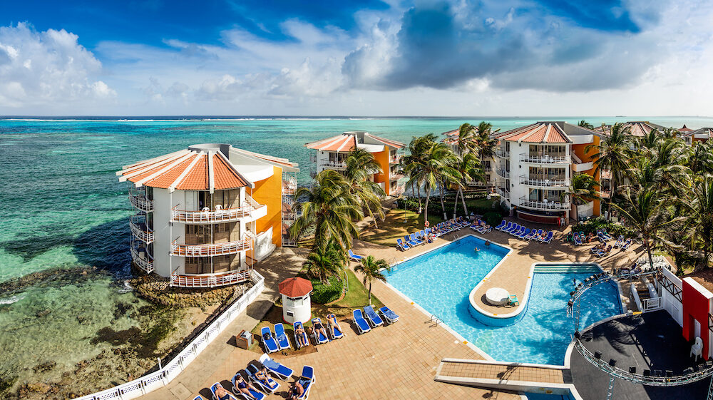 San Andres Colombia . XXXL resolution Panorama of a Portion of Decameron Aquarium Hotel Resort where we can see the Pool the stage and a few Hotel with a beautiful view of the Caribbean sea