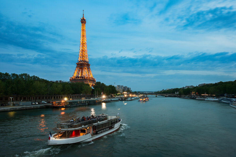 Paris, Fracne - : Seine river night view with Eiffel tower in Paris, France. Paris is the capital and most populous city of France.