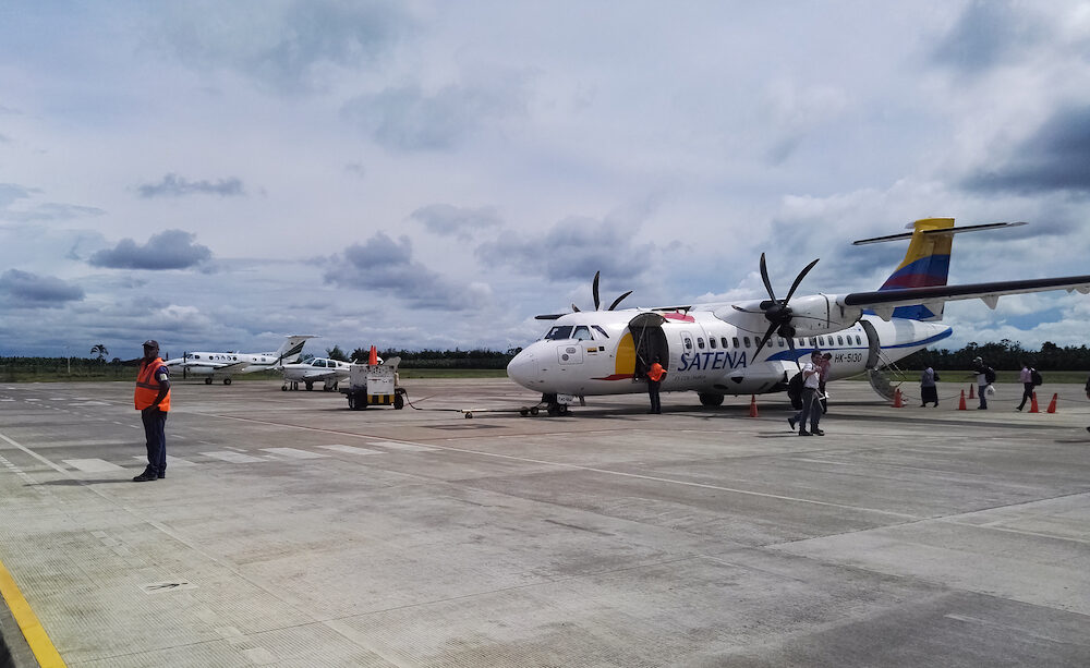 Apartado, Antioquia, Colombia -Passengers boarding a small plane with propeller engines from the runway of Antonio Roldan Betancourt Airport in Apartado, Colombia.