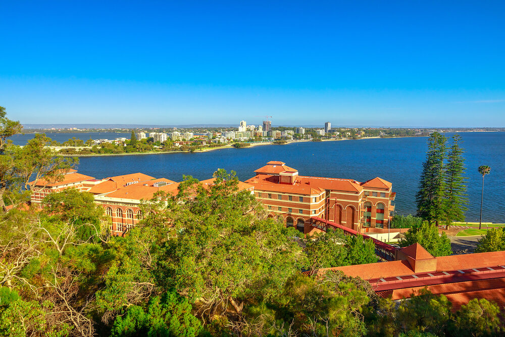 Aerial view of South Perth suburb from Kings Park and Botanical Garden on the Swan River, Western Australia. Sunny day, blue sky with copy space. Perth urban skyline in summertime.