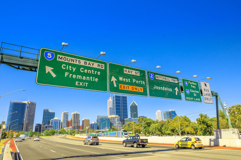 Perth, Western Australia - : Perth highway road sign of Fremantle City Center, West Perth, Jondalup, Farmer Fwy and Charles St in Perth Downtown near John Oldham Park. Traffic urban scene.