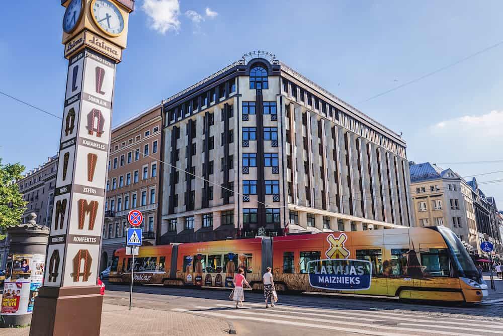Riga, Latvia - Roma Hotel and Laima Clock on the Old Town of Riga city