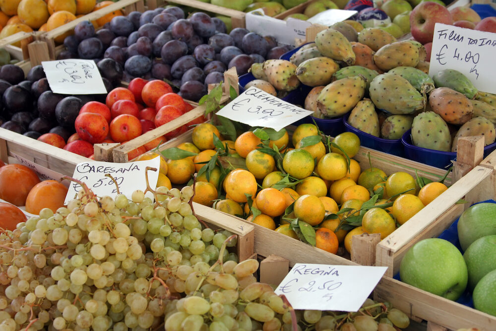 These gorgeous fruits, stacked in rustic crates, are on display in one of Rome's open-air farmer's markets.