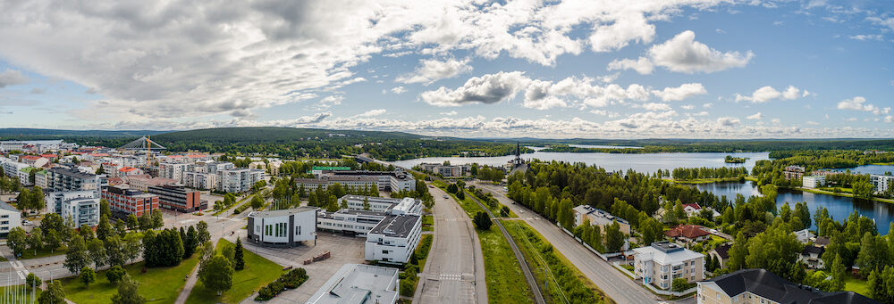 Rovaniemi Finland, panorama of the city with Kemijoki river in the back and Ounasvaara fell with the city heart at the left