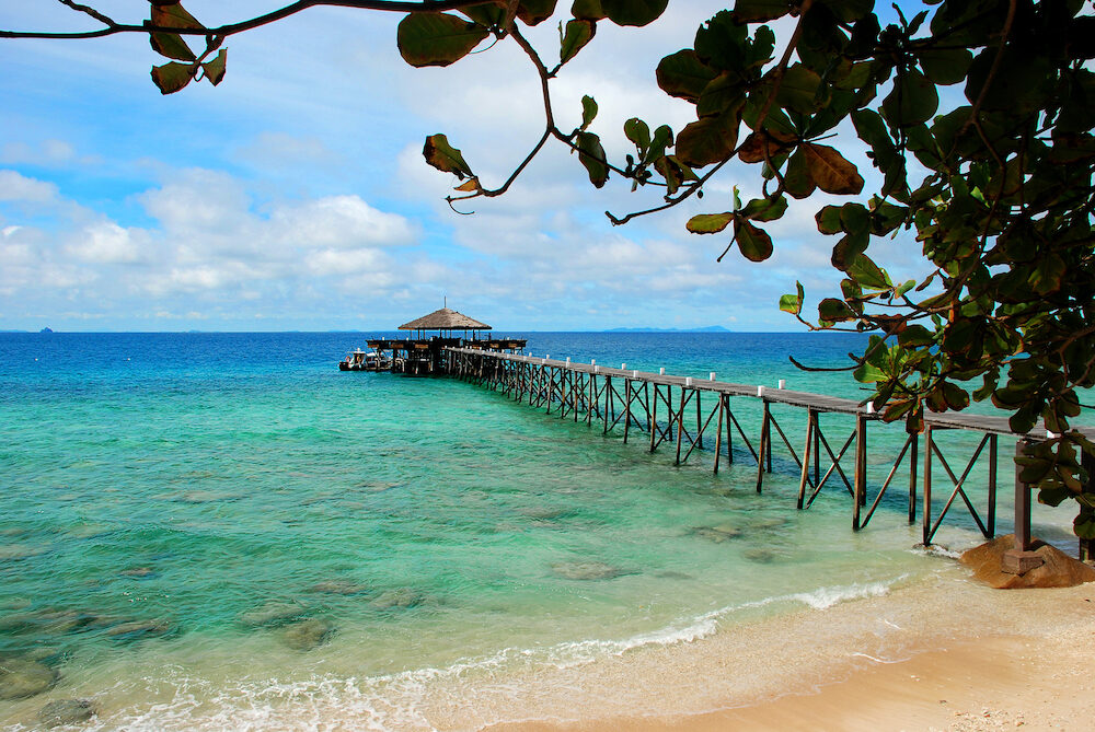 Jetty over clear turquoise waters of Tioman Island Malaysia