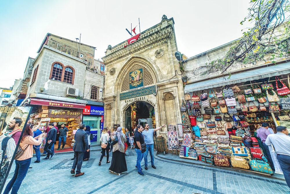 ISTANBUL, TURKEY- on : Exterior view of the Grand Bazar Gate.Unidentified Tourists visiting and shopping in the Grand Bazaar in Istanbul.