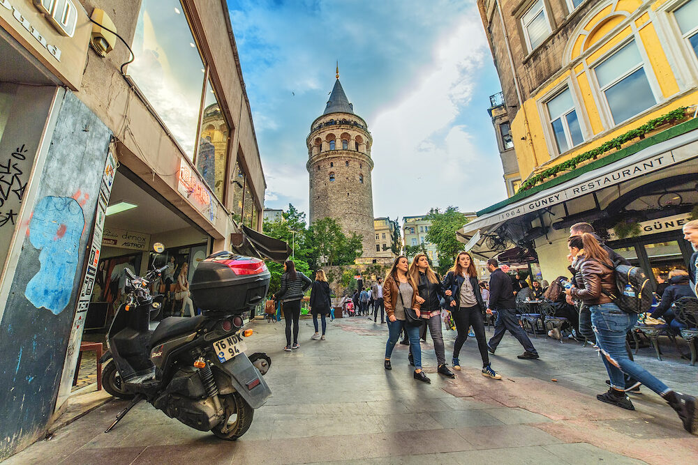 ISTANBUL, TURKEY: People walking near Galata tower - a famous landmark of Istanbul
