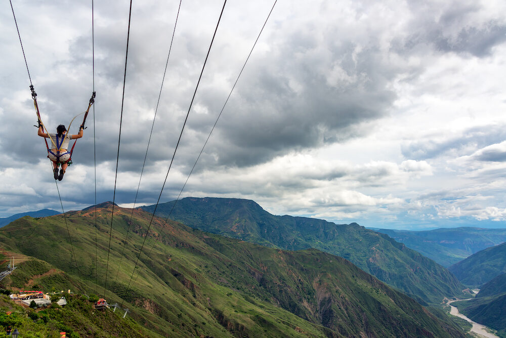 CHICAMOCHA CANYON COLOMBIA - : Woman zip lines through Chicamocha Canyon Colombia