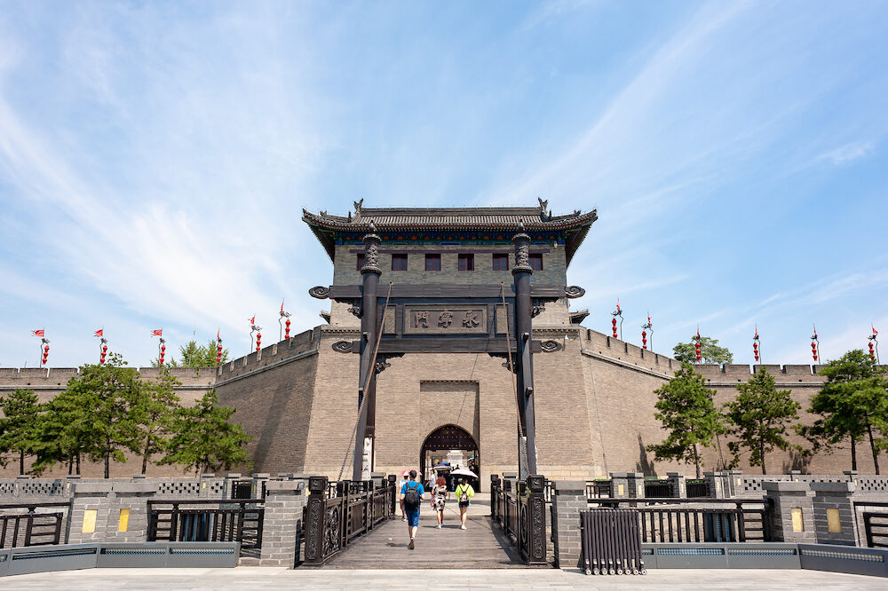 Xian, Shaanxi province, China - Tourists walking by the Xian city wall south gate - YongNingMen on a sunny day in summer.