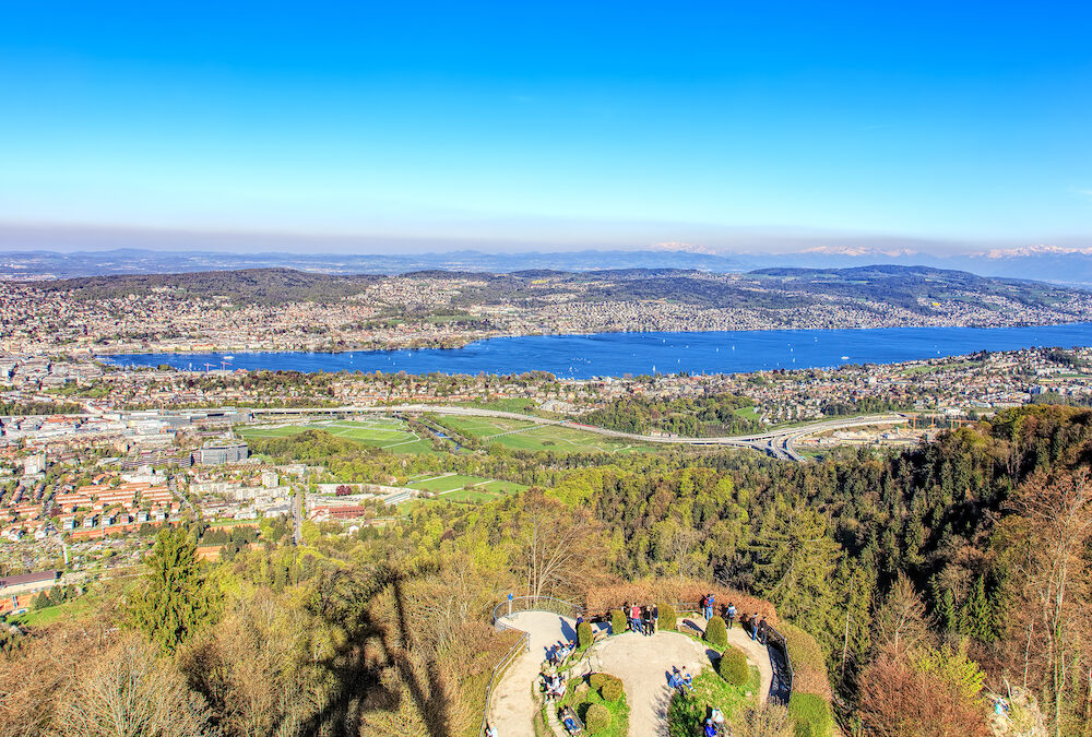 Zurich, Switzerland - view on the city of Zurich and Lake Zurich from Mt. Uetliberg. Mt.Uetliberg is a mountain of the Swiss plateau rising to 869 m it offers a panoramic view on the entire city of Zurich and the Lake Zurich.