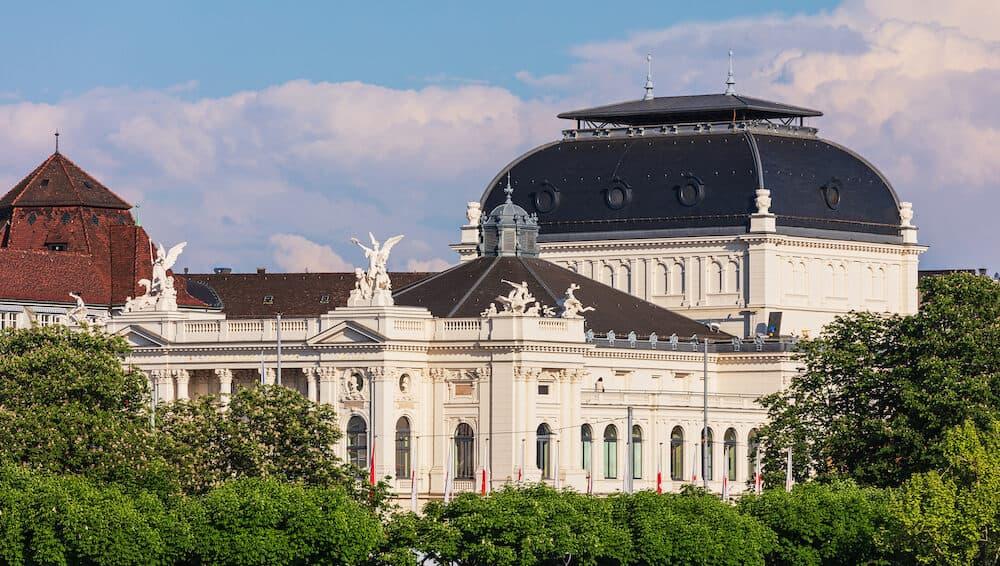 Zurich, Switzerland - upper part of the Zurich Opera House building. Zurich Opera House (German: Opernhaus Zurich) is an opera house in the Swiss city of Zurich, located at Sechselautenplatz square.