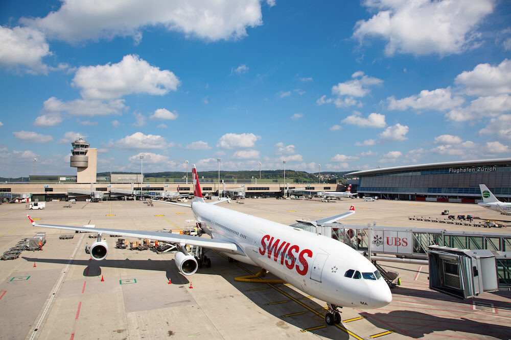 ZURICH - Planes preparing for take off at Terminal A of Zurich Airport in Zurich, Switzerland. Zurich airport is home port for Swiss Air and one of european hubs.