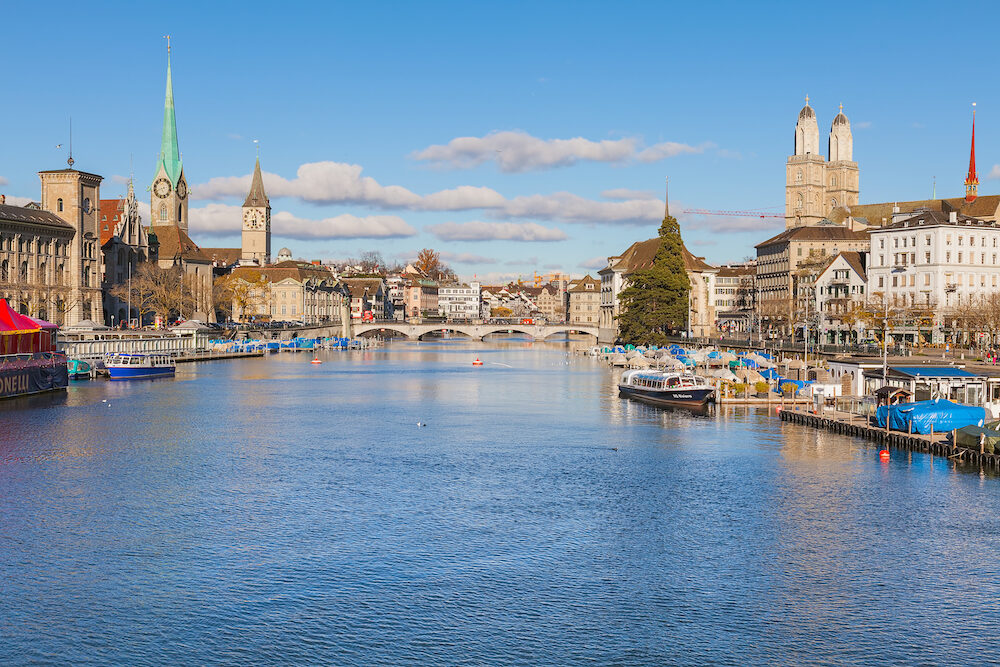 Zurich, Switzerland - view along the Limmat river, buildings of the historic part of the city. Zurich is the largest city in Switzerland and the capital of the Swiss canton o Zurich.
