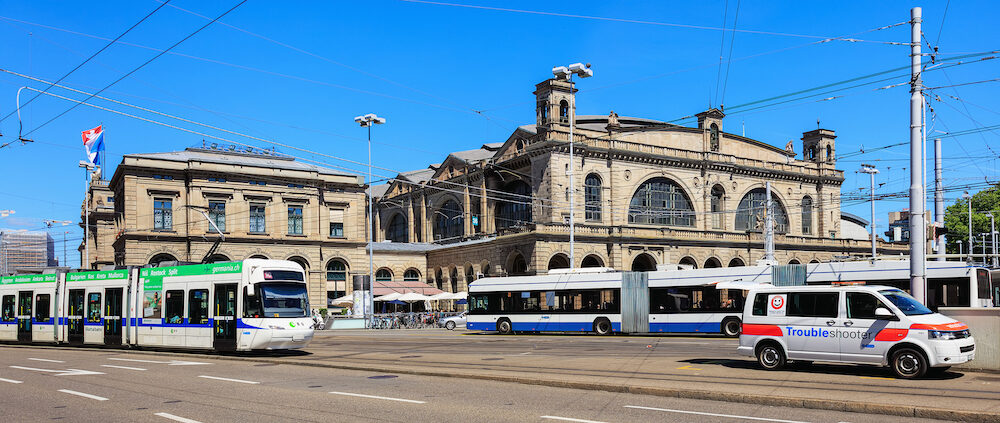 Zurich, Switzerland - the building of the Zurich main railway station, traffic in front of it. Zurich main railway station is the largest railway station in Switzerland and one of the busiest railway stations in the world.