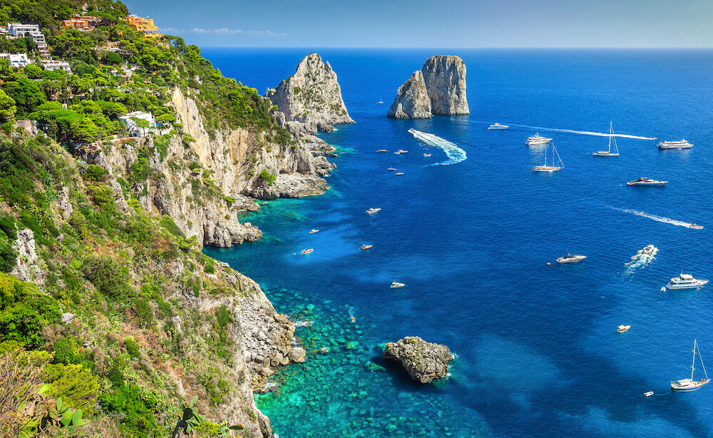 Amazing Faraglioni cliffs panorama with the majestic Tyrrhenian sea in background Capri island Campania region Italy Europe