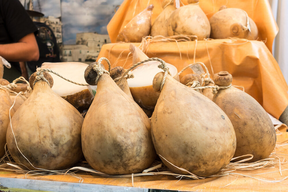 Many forms of caciocavallo cheese on sale in Italian market