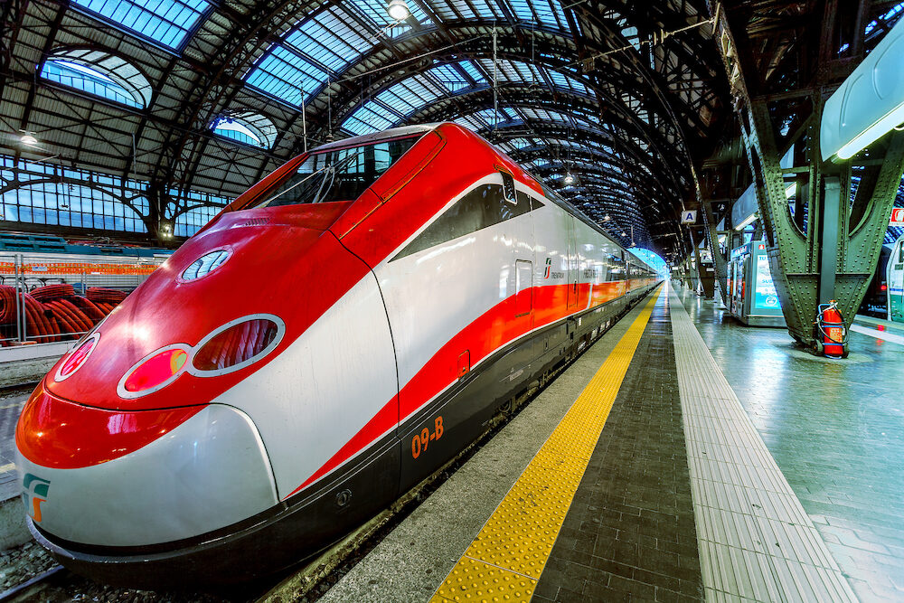 MILAN, ITALY -Trenitalia Frecciarossa (red arrow) on Milan Central Station. This high speed train can reach 300 km/h and operate Turin-Milan-Bologna-Florence-Rome-Naples route.
