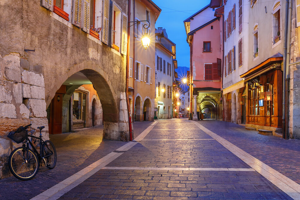 Nice street Rue Sainte-Claire in Old Town of Annecy at rainy night, France