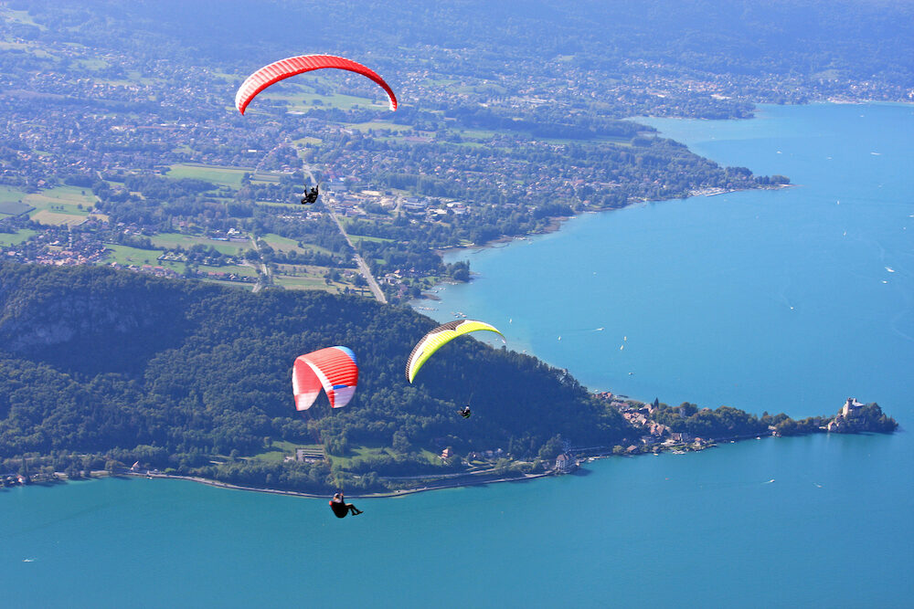 Paragliders flying wings above Lake Annecy, France