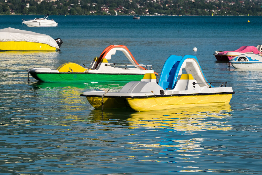 Pedal boats or paddle boats with water slides at Lake Annecy at Haute-Savoie department. France