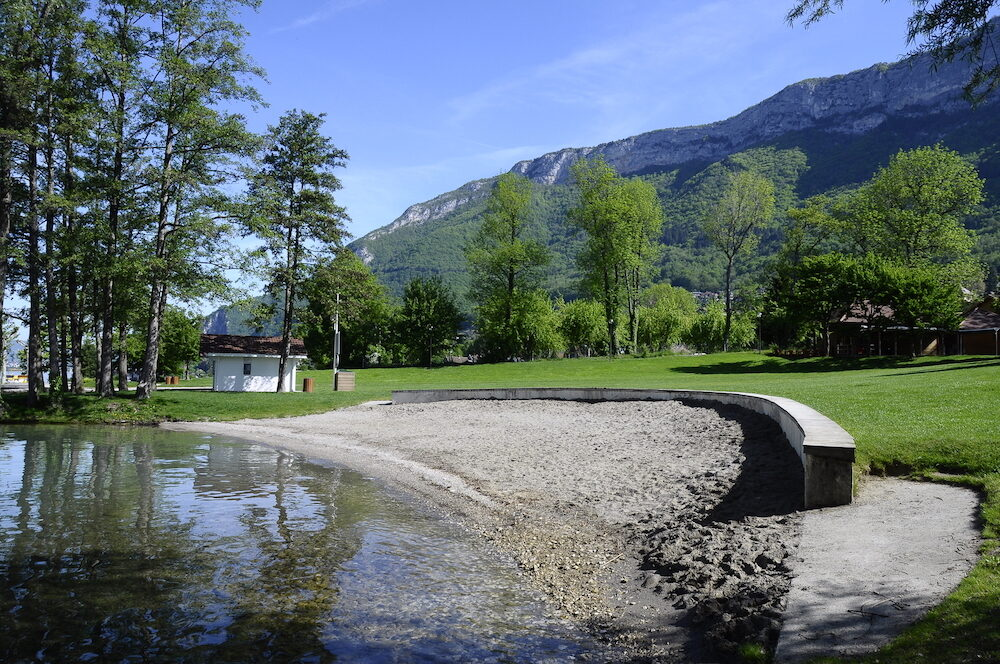 Sand beach and lawn on Annecy lake in Veyrier du lac France