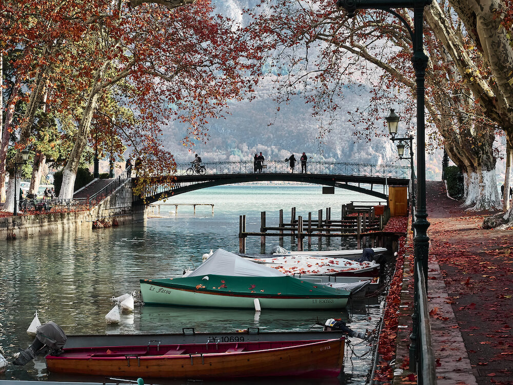 Annecy, France - : Shot of the beautiful Canal du Vassè which brings to the romantic Pont de Amours in Annecy, France. The canal is full of boats. The shot is taken in autumnal season