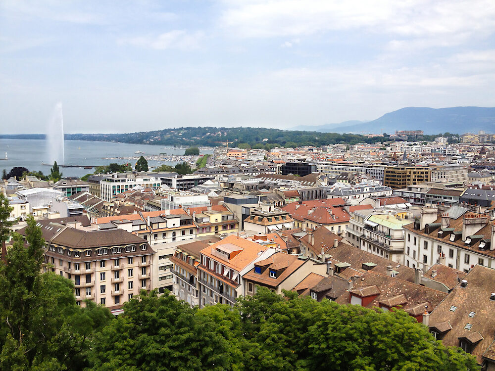 Top view of Geneva old town and Lake Geneva with Jet d'eau fountain as symbol of Geneva city, Switzerland, Europe.