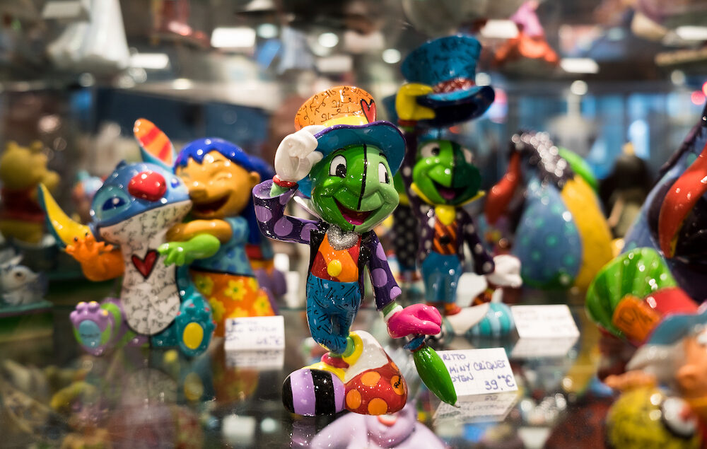 ANNECY FRANCE - funny souvenir green frog gentleman for sale at gift store in Annecy. France