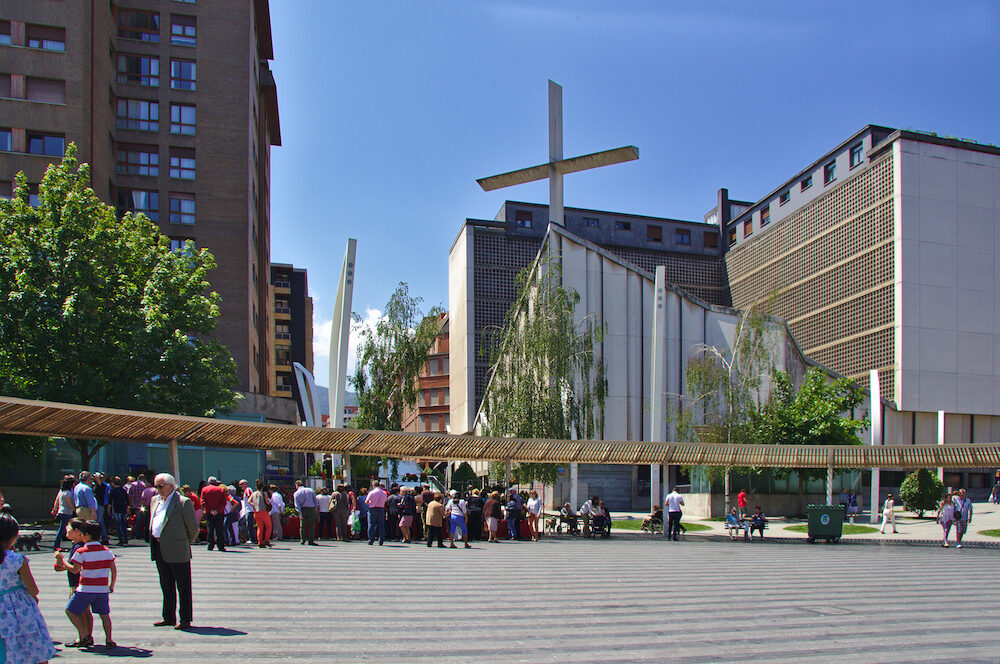 BILBAO, SPAIN - Indautxu square and Our Lady of Mount Carmel parish with people.