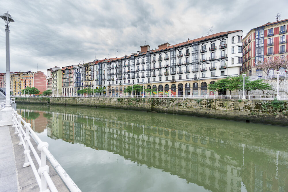 Wide angle view of Bilbao la vieja and Nervion river with cloudy sky