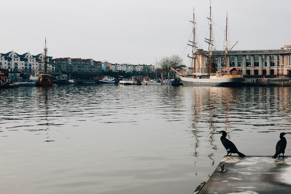 BRISTOL, UK - View of Bristol Harbourside on a sunny day, UK. Barque Kaskelot moored by Waterfront Square.