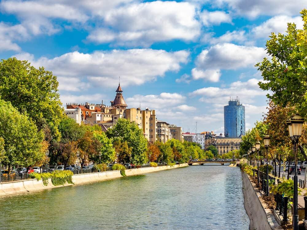 Dambovita river across the city of Bucharest in autumn season, Romania