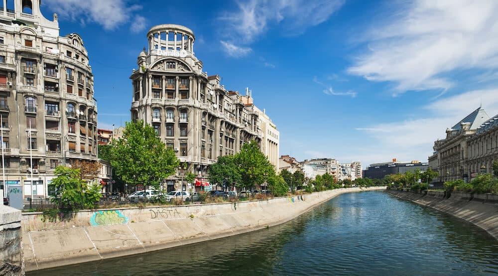 Bucharest, Romania - Panoramic view of Dambovita River and Blocul Adriatica-Trieste, Imobilul Adriatica located on Calea Victoriei, Romania. Historical Buildings in Bucharest