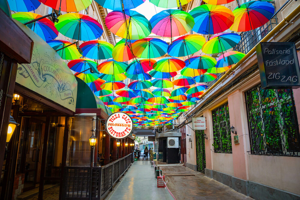 Bucharest, Rumania - Rainbow umbrellas roof street in Victory Passage , Bucharest, Romania