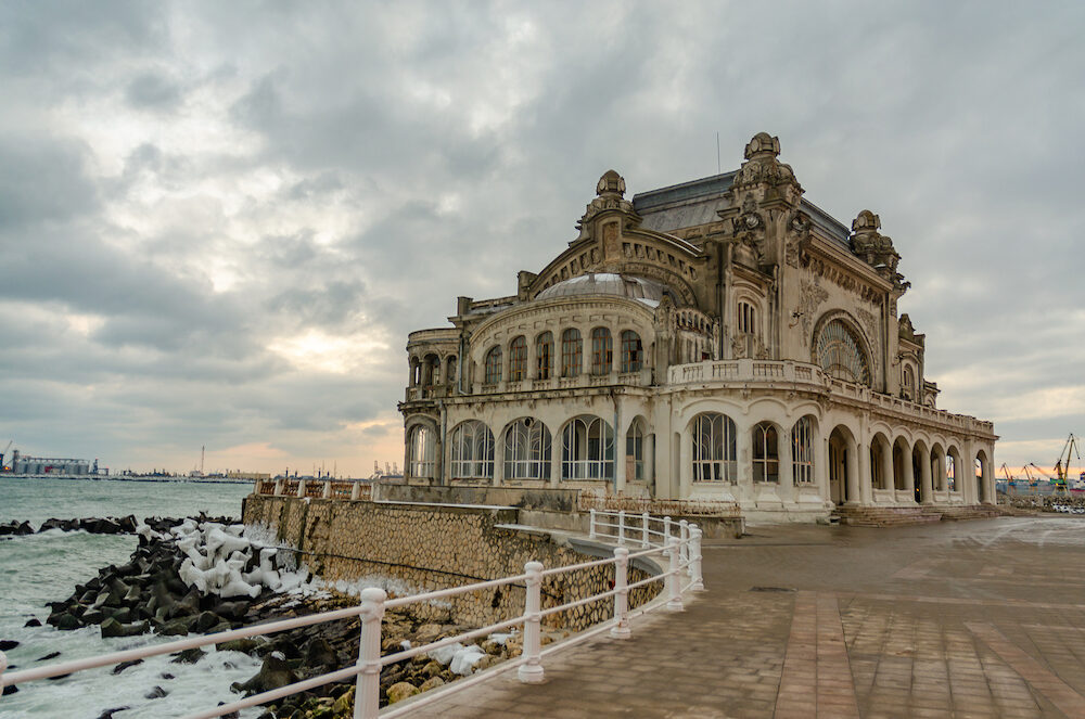 casino constanta Romania at the Winter with cloudy sky and ice in the stones