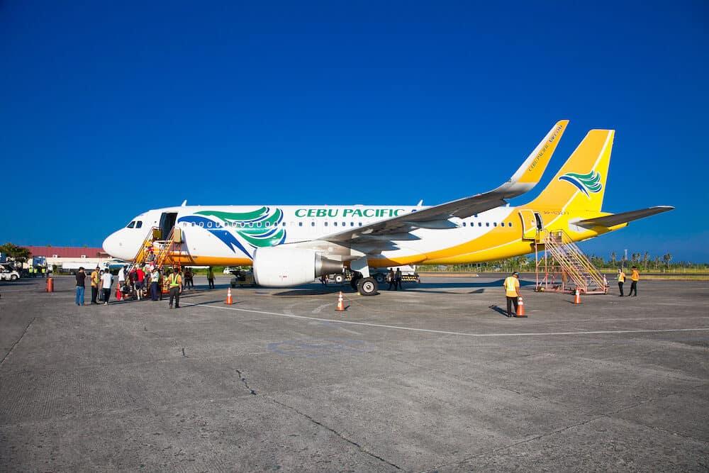 PUERTO PRINCESA ,PHILIPPINES -Tourists embark on the Cebu Pacific aircraft at Puerto Princesa Airport.Philippines,Main hub is at Ninoy Aquino Airport