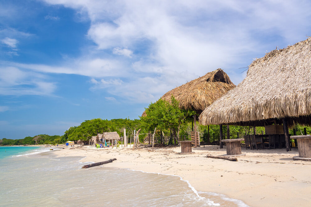 Simple beach huts on beach at Playa Blanca near Cartagena Colombia