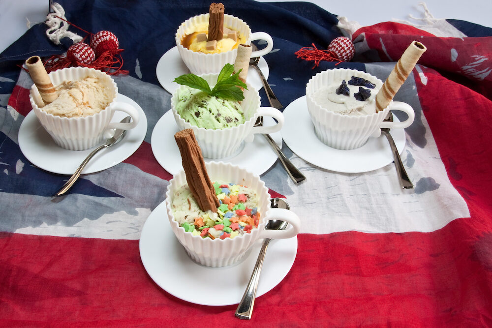 Tea cups filled with ice creams and toppings